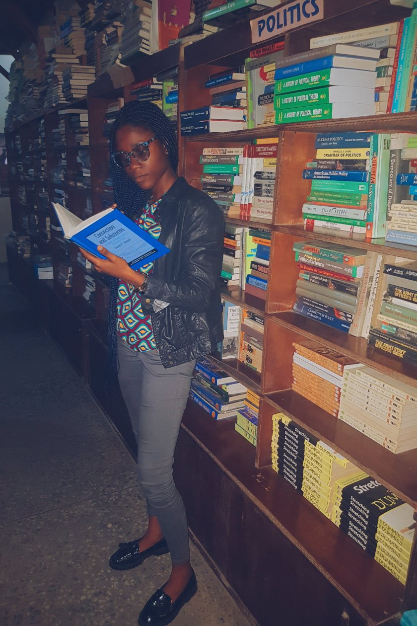 Black girl reading a book